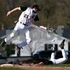 Beck Diefenbach  -  bdiefenbach@daily-chronicle.com<br /> <br /> DeKalb's Mike Meier (21, top) can't stop the ball as Sycamore's Eric Ray (5) slides safe into third base during the first inning of the game at DeKalb High School in DeKalb, Ill., on Friday April 9, 2010.