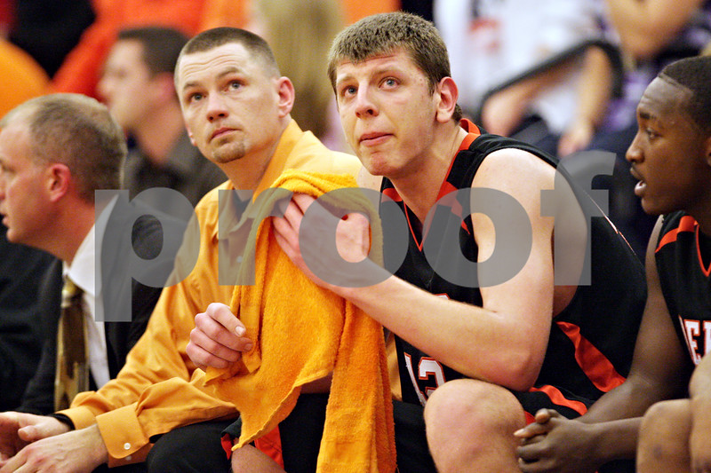 Beck Diefenbach - bdiefenbach@daily-chronicle.com<br /> <br /> DeKalb's Jordan Threloff (42, left) watches time run down after fouling out during the fourth quarter of the sectional championship game against Oswego at Hampshire High School in Hampshire, Ill., on Friday March 12, 2010. Oswego defeated DeKalb 57 to 51, ending the Barb's season.