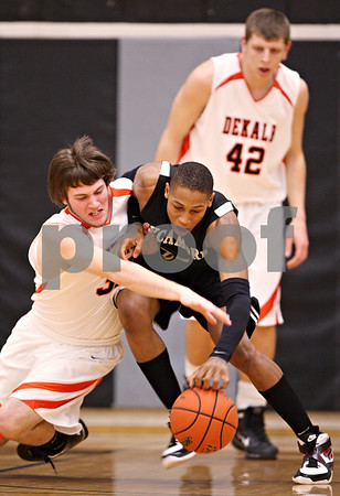 Beck Diefenbach - bdiefenbach@daily-chronicle.com<br /> <br /> DeKalb's (32, left) and Sycamore's Sam Ford (25, right) battle for a loose ball during the first quarter of the IHSA Class 3A regional semifinal game at Kaneland High School in Maple Park, Ill., on Tuesday March 2, 2010.