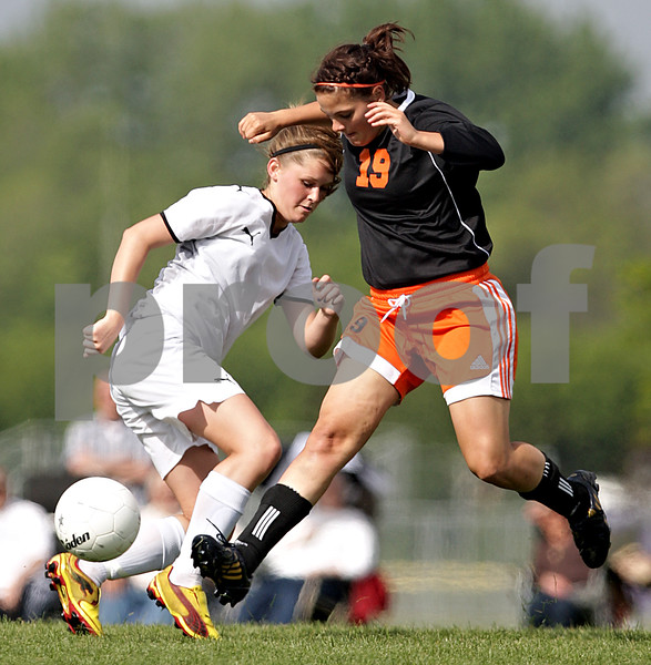 Beck Diefenbach  -  bdiefenbach@daily-chronicle.com<br /> <br /> Sycamore's Katelyn Brown (11, left) and DeKalb Audrey Mascal (19) fight for the ball during the first half of the IHSA Class 2A Rochelle Regional Championship at Rochelle Township High School in Rochelle, Ill., on Friday May 21, 2010. Sycamore defeated DeKalb 2 to 1.