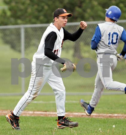 Beck Diefenbach  -  bdiefenbach@daily-chronicle.com<br /> <br /> DeKalb's Cody Varga (11, left) reacts after the final out clinches the win against Geneva at DeKalb High School in DeKalb, Ill., on Wednesday May 12, 2010. DeKalb defeated Geneva 4 to 3.