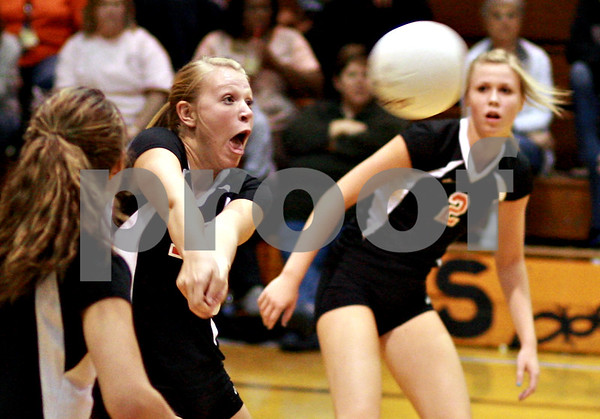 Beck Diefenbach  -  bdiefenbach@daily-chronicle.com<br /> <br /> DeKalb's Mackenzie Johnson (14) returns the ball during the first game of a match against Geneva at DeKalb High School in DeKalb, Ill., on Thursday Sept. 9, 2010. Geneva defeated DeKalb 2 to 0.