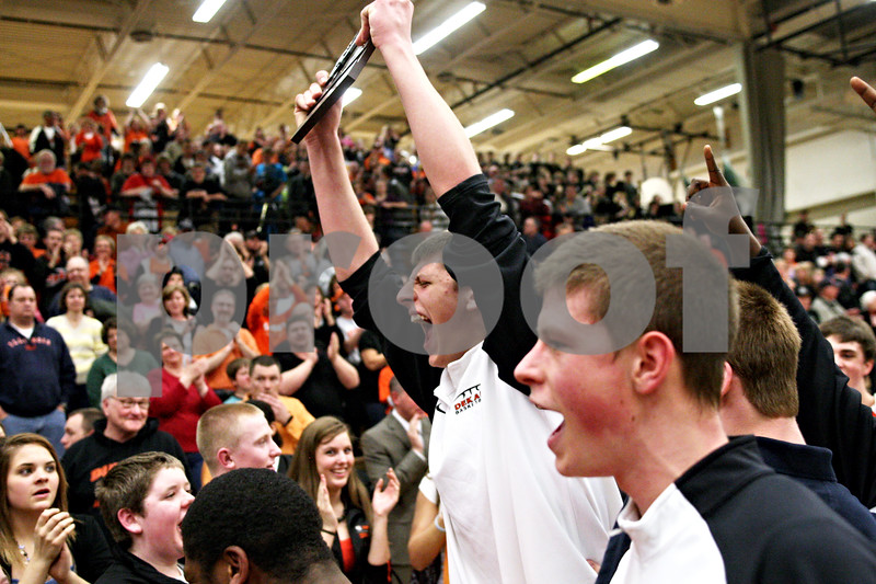 Beck Diefenbach - bdiefenbach@daily-chronicle.com<br /> <br /> DeKalb's Jordan Threloff leads the team in celebrating holding the regional championship plaque after defeating Kaneland in the IHSA Class 3A Regional championship game at Kaneland High School in Maple Park, Ill., on Friday March 3, 2010.