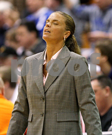 Beck Diefenbach  -  bdiefenbach@daily-chronicle.com<br /> <br /> DeKalb head coach Debbie Whitman reacts as Geneva widens their lead during the second quarter of the game at DeKalb High School, in DeKalb, Ill., on Friday Jan. 5, 2010. Geneva defeated DeKalb 44 to 41.