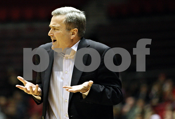 Rob Winner – rwinner@daily-chronicle.com<br /> <br /> Northwestern coach Bill Carmody communicates to one of his players during the first half in DeKalb, Ill. on Friday November 12, 2010.