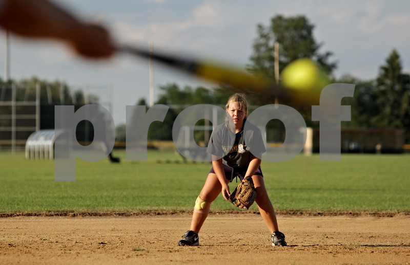 Beck Diefenbach  -  bdiefenbach@daily-chronicle.com<br /> <br /> Katie Kelly prepares for a ground ball during tryouts for a new travel fastpitch softball team called Sycamore Flash, at the Sycamore High School softball field in Sycamore, Ill., on Wednesday July 28, 2010.