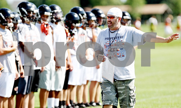 Rob Winner – rwinner@daily-chronicle.com<br /> <br /> DeKalb head coach Marty Sanders addresses his team before the start of their first practice on Wednesday August 11, 2010.