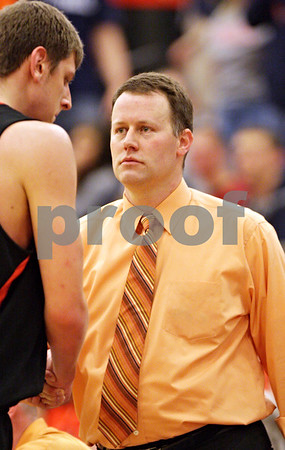 Beck Diefenbach - bdiefenbach@daily-chronicle.com<br /> <br /> DeKalb head coach Dave Rohlman shakes the hand of Jordan Threloff after he fouls out of the game during the fourth quarter of the sectional championship game against Oswego at Hampshire High School in Hampshire, Ill., on Friday March 12, 2010. Oswego defeated DeKalb 57 to 51, ending the Barb's season.