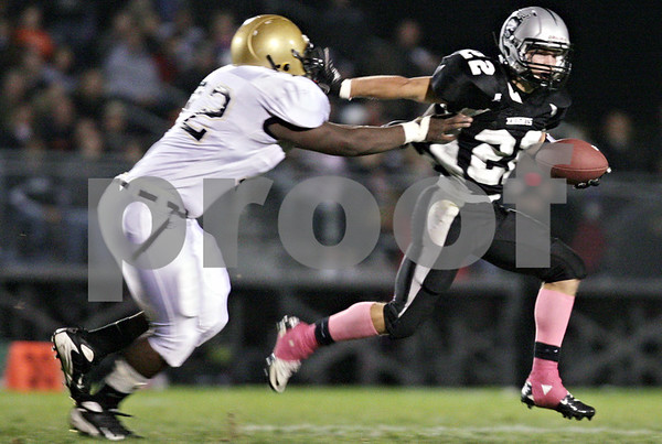 Rob Winner – rwinner@daily-chronicle.com<br /> <br /> Sycamore's Darrell Mayweathers (left) is stiff-armed by Kaneland's Quinn Buschbacher during the first quarter of their game in Maple Park, Ill. on Friday October 15, 2010.