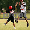 Beck Diefenbach  -  bdiefenbach@daily-chronicle.com<br /> <br /> DeKalb's Javon Scruggs (28, right) catches a pass over Danny Petras (36, left) during practice at DeKalb High School in DeKalb, Ill., on Thursday Sept. 9, 2010.