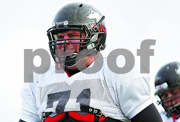 Rob Winner – rwinner@daily-chronicle.com<br /> <br /> NIU center Scott Wedige works out during practice at Huskie Stadium in DeKalb, Ill. on Thursday April 8, 2010.