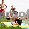 Rob Winner – rwinner@daily-chronicle.com<br /> <br /> Genoa residents Ilana Holtz, 23 months, and her brother Jarrod Holtz, 13, cool off on a Slip 'N Slide at their home in Genoa, Ill. on Thursday July 15, 2010.