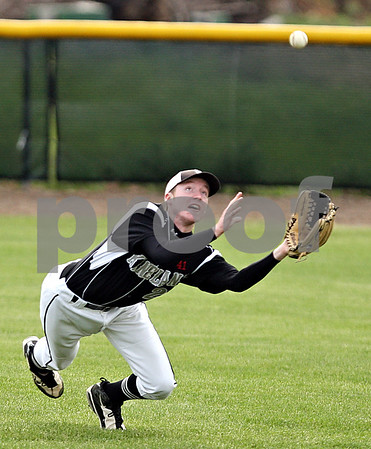 Beck Diefenbach  -  bdiefenbach@daily-chronicle.com<br /> <br /> Kaneland's Steve Colombe (21) makes a leaping catch during the sixth inning of the game against Sycamore at Kishwuakee College in Malta, Ill., on Friday May 14, 2010.