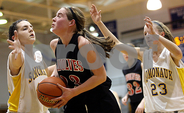 Rob Winner – rwinner@daily-chronicle.com<br /> Indian Creek's Lauren Anderson (center) drives past Somonauk defenders Karrah Kuykendall (left) and Ashlee Kawall during the second quarter of their game at the Little 10 tournament in Hinckley, Ill. on Monday January 18, 2010.