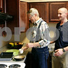 Rob Winner – rwinner@daily-chronicle.com<br /> <br /> Gary Christensen (left), of Oregon, retrieves items from a kitchen cabinet in a simulated living space while occupational therapist Dave Lipanot watches at the Pine Acres Rehab and Living Center in DeKalb on Tuesday. Christensen suffered a stroke in 2008 and has suffered from seizures ever since.
