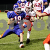 Rob Winner – rwinner@daily-chronicle.com<br /> <br /> Genoa-Kingston's Matthew Volkening carries the ball after a completion during the second quarter of their game in Genoa, Ill. on Friday October 1, 2010.