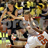Beck Diefenbach  I  bdiefenbach@daily-chronicle.com<br /> <br /> Sycamore guard Kate Binder (21) claims a loose ball from DeKalb guard Alexis Ford (3) and guard Michelle Todd (25) during the second quarter of the game at the Northern Illinois University Convocation Center in DeKalb, Ill., on Friday Jan. 30, 2009.