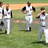 Rob Winner – rwinner@daily-chronicle.com <br /> <br /> The Barbs, including Cody Varga (from left), Frank Petras, Paul Severino and Justin Keck, leave the field after falling to Chatham Glenwood 11-1 in six innings during the IHSA Class 3A championship on Saturday June 12, 2010 in Joliet, Ill.