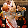 Beck Diefenbach  -  bdiefenbach@daily-chronicle.com<br /> <br /> DeKalb's Jordan Threloff (42, left) battles Batavia's Levi Maxey (40) for a rebound during the second quarter of the game at DeKalb High School in DeKalb, Ill., on Tuesday Jan. 26, 2010.