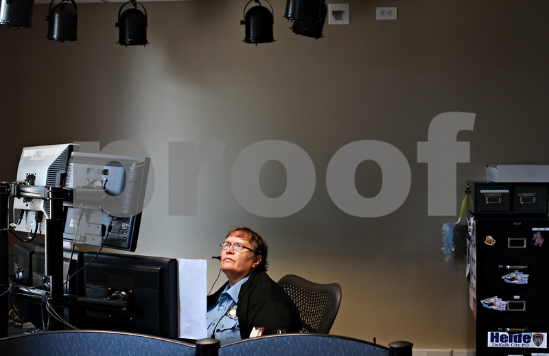 Beck Diefenbach  -  bdiefenbach@daily-chronicle.com<br /> <br /> Telecommunicator Juanita Burke coordinates response as she fields a 911 call at the new communications room at the DeKalb Police Department in DeKalb, Ill., on Tuesday Aug. 31, 2010.