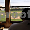 Beck Diefenbach  -  bdiefenbach@daily-chronicle.com<br /> <br /> Ohio University radio announcer Russ Eisenstein calls out the play-by-play during the Northern Illinois vs Ohio baseball game at NIU in DeKalb, Ill., on Friday April 16, 2010.