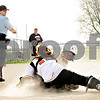 Beck Diefenbach  -  bdiefenbach@daily-chronicle.com<br /> <br /> Kaneland's Samantha Hansen (5, right) is tagged out at home Dekalb catcher Alysha Guy (12) during the second inning of the game at DeKalb High School in DeKalb, Ill., on Tuesday April 13, 2010.