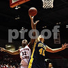 Rob Winner – rwinner@daily-chronicle.com<br /> NIU's Mauvolyene Adams (left) and Kent State's Ellie Shields go up for a rebound under the Huskies' basket in the first half during their game on Saturday January 30, 2010 at the Convocation Center in DeKalb, Ill.