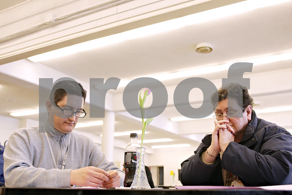 Beck Diefenbach  -  bdiefenbach@daily-chronicle.com<br /> <br /> Richard Salazaar (left) and his fiance XXXX pray during a reconciliation event at the Newman Catholic Center in DeKalb, Ill., on Saturday March 20, 2010.