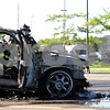 Beck Diefenbach  -  bdiefenbach@daily-chronicle.com<br /> <br /> DeKalb firefighters inspect a Lincoln Aviator after extinguishing the flames in the Walmart parking lot in DeKalb, Ill., on Friday July 2, 2010.
