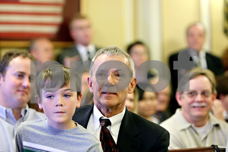 Rob Winner – rwinner@daily-chronicle.com<br /> <br /> Tom Doherty (right) sits with his grandson Tom Johannesen, 9, before being sworn in on Monday afternoon at the DeKalb County Courthouse in Sycamore.