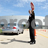 Rob Winner – rwinner@daily-chronicle.com<br /> <br /> Daniel DeCastris, of Rockford, helps direct traffic outside the Convocation Center in DeKalb, Ill. during a Jehovah's Witness convention on Friday June 18, 2010.
