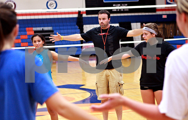Beck Diefenbach - bdiefenbach@daily-chronicle.com<br /> <br /> New head coach Keith Foster leads his players in developing a new warm up routine during practice at Genoa-Kingston High School in Genoa, Ill., on Thursday Aug. 19, 2010.