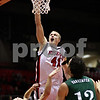 Beck Diefenbach  -  bdiefenbach@daily-chronicle.com<br /> <br /> Northern Illinois' Sean Kowal (41, top) dunks the ball while being fouled by Ohio's Tommy Freeman (24) during the first half of the game at NIU's Convocation Center in DeKalb, Ill., on Wednesday Jan. 27, 2010.
