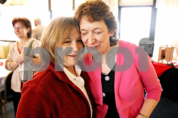 Rob Winner – rwinner@daily-chronicle.com<br /> <br /> Ann Nelson (left) and Nancy Kasinski embrace during a retirement reception for Kasinski in the Sky Room at the Holmes Student Center in DeKalb, Ill. on Wednesday May 12, 2010. Kasinski is retiring on May 31 after 32 years at Northern Illinois University.