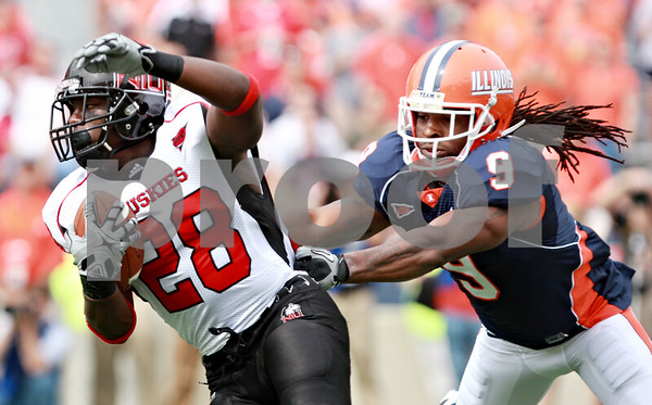 Rob Winner – rwinner@daily-chronicle.com<br /> <br /> Northern Illinois running back Chad Spann eludes Illinois defensive back Trulon Henry during the first half in Champaign, Ill.  on Saturday September 18, 2010.
