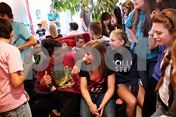 Beck Diefenbach  -  bdiefenbach@daily-chronicle.com<br /> <br /> (From left) Spanish exchange student Pablo Moreno talks with Sycamore High School sophomores Catie Robinson and   Kendra Johnson during a mixer event at the House Cafe in DeKalb, Ill., on Tuesday May 4, 2010.