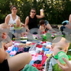 Beck Diefenbach  -  bdiefenbach@daily-chronicle.com<br /> <br /> Jacob Leigh (lower right), 10 months, drinks from his bottle during a Crunchie Moms playdate at Sycamore Lake Rotary Park in Sycamore, Ill., on Thursday July 29, 2010.