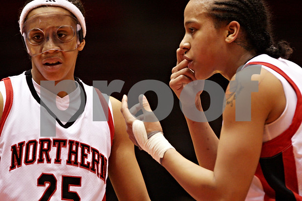 Beck Diefenbach  -  bdiefenbach@daily-chronicle.com<br /> <br /> Northern Illinois' Sarah Rogers (24, right) talks with Bianca Brown (25, left) during the first half of the game against Central Michigan at the NIU Convocation Center in DeKalb, Ill., on Wednesday Jan. 20, 2010