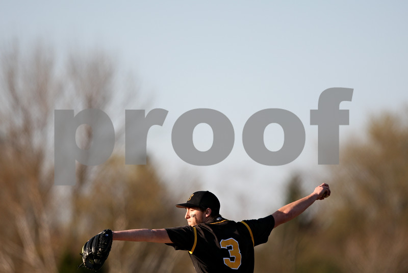 Beck Diefenbach  -  bdiefenbach@daily-chronicle.com<br /> <br /> Sycamore's pitcher Danny Schroeder (3) winds up during the fourth inning of the game against Sycamore at DeKalb High School in DeKalb, Ill., on Friday April 9, 2010