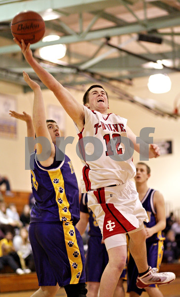 Beck Diefenbach  -  bdiefenbach@daily-chronicle.com<br /> <br /> Indian Creek's Cal Herrmann (12) shoots the ball during the first quarter of the Little Ten Tournament first round game against Paw Paw at Somonaulk High School in Somonaulk, Ill., on Monday Feb. 1, 2010.