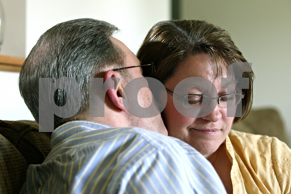 Rob Winner – rwinner@daily-chronicle.com<br /> <br /> Jess Chilson gives his wife, Cheryl Chilson, a kiss on the cheek at their home in Sycamore, Ill. on Tuesday April 27, 2010. The Chilson's have been married for nearly 25 years.