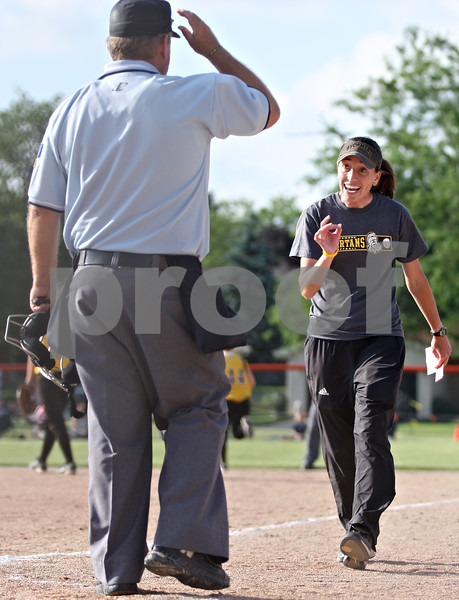 Rob Winner – rwinner@daily-chronicle.com<br /> <br /> Sycamore coach Jill Carpenter talks to the home plate umpire after two runs score on a dropped third strike in the bottom of the sixth inning with two outs during the IHSA Class 3A DeKalb Sectional semifinal on Wednesday June 2, 2010 in DeKalb, Ill.