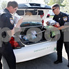 Rob Winner – rwinner@daily-chronicle.com<br /> <br /> Officers Todd Wells (left) and Sgt. Jim McDougall remove blankets donated from DeKalb High School students from a squad car at the DeKalb Police Department in DeKalb, Ill. on Wednesday April 21, 2010.
