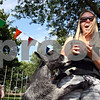 Rob Winner – rwinner@daily-chronicle.com<br /> <br /> A goat jumps on Cortland resident Renee Mecklenburg within the petting zoo at the Cortland Summer Fest in Cortland, Ill. on Saturday August 7, 2010.