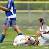 Beck Diefenbach  -  bdiefenbach@daily-chronicle.com<br /> <br /> Sycamore's Emma Norris (7, down) is tended to by Jessica Johnson (4, right) after injuring her knee during the second half of the IHSA Class 2A Hampshire Sectional Semi-final game against Rosary at Hampshire High School in Hampshire, Ill., on Tuesday May 25, 2010. Sycamore defeated Rosary 3 to 1.