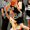 Beck Diefenbach - bdiefenbach@daily-chronicle.com<br /> <br /> Kaneland's Steve Colombe (21, front) looks for a pass after DeKalb's Pat Rourke (25) tries to steal the ball during the third quarter of the IHSA Class 3A Regional championship game at Kaneland High School in Maple Park, Ill., on Friday March 3, 2010.