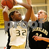 Rob Winner – rwinner@daily-chronicle.com<br /> Sycamore's Montia Johnson looks to shoot while Kelly Evers provides defense for Kaneland. Sycamore defeated Kaneland, 62-52.
