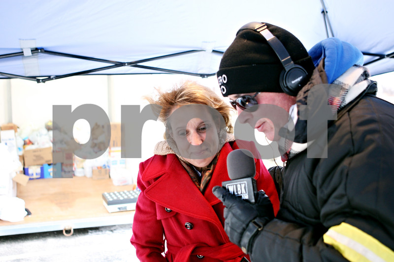 Rob Winner – rwinner@daily-chronicle.com<br /> <br /> Kim Zamora of Lincolnshire Place, a sponsor of Freezin' for Food, is interviewed by Terry Ryan of 1360 WLBK on the air during the annual food drive on Wednesday in DeKalb.
