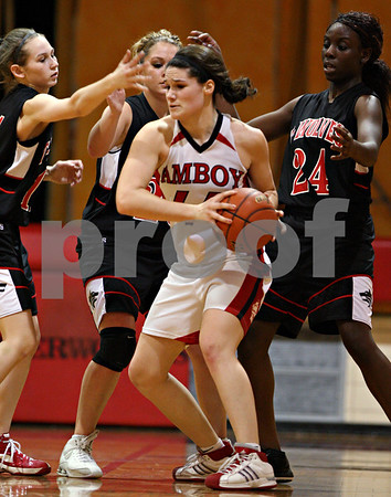 Beck Diefenbach – bdiefenbach@daily-chronicle.com<br /> <br /> Amboy's Katie Nauman (44, front) is surrounded by Indian Creek's (from left) Ariel Russell (11), Carson Day (20) and Michelle Crayton (24) during the second quarter of the IHSA Class 1A Regional playoff game at Indian Creek High School in Shabbona, Ill., on Wednesday Feb. 10, 2010.