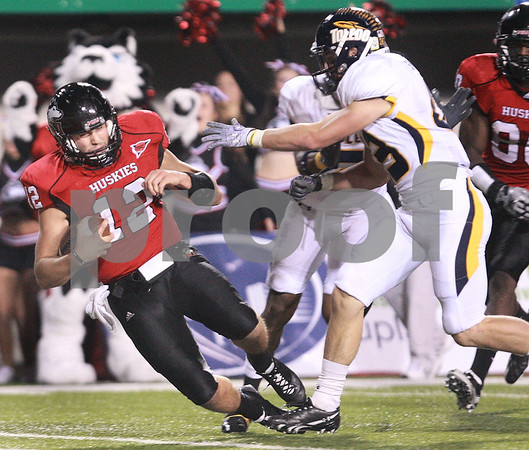 Kyle Bursaw - kbursaw@daily-chronicle.com<br /> <br /> Northern Illinois quarterback Chandler Harnish (12) falls in for a touchdown in the second quarter during the game against the Toledo in DeKalb, Ill. on Nov. 9, 2010.